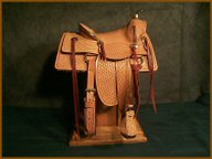Handmade miniature saddle.